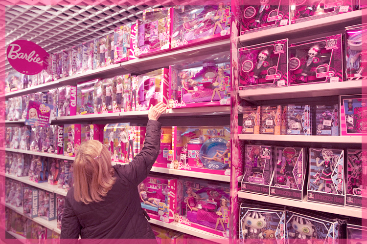 A customer looks in the doll section for a gift in the Village of Paris JoueClub toy shop during the holiday season in Paris November 30, 2011.  REUTERS/Charles Platiau